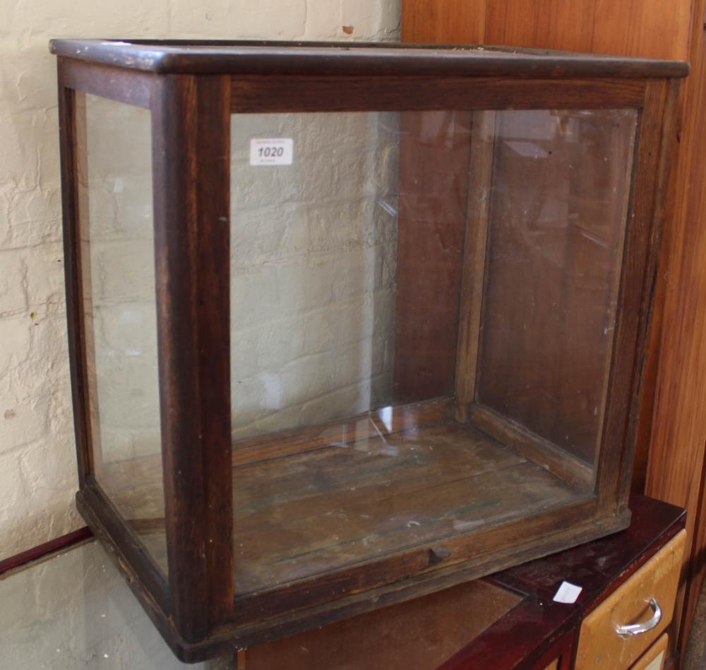Lot 1020 - An oak glazed table top display case