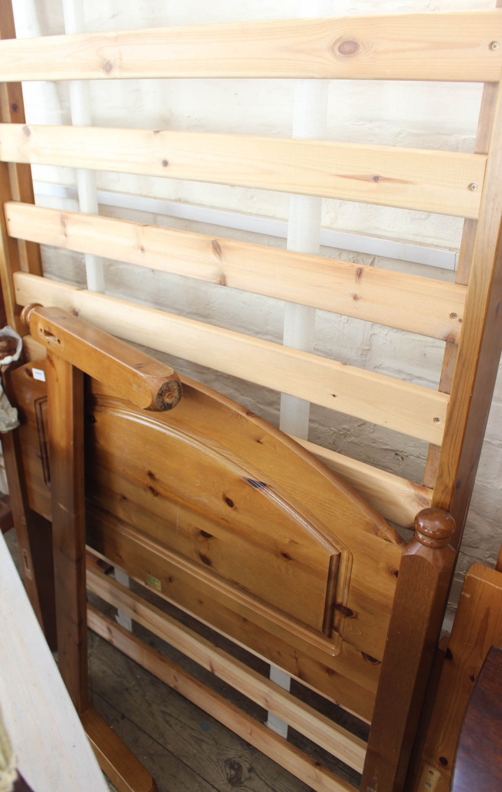Lot 1005 - A pine single bed frame