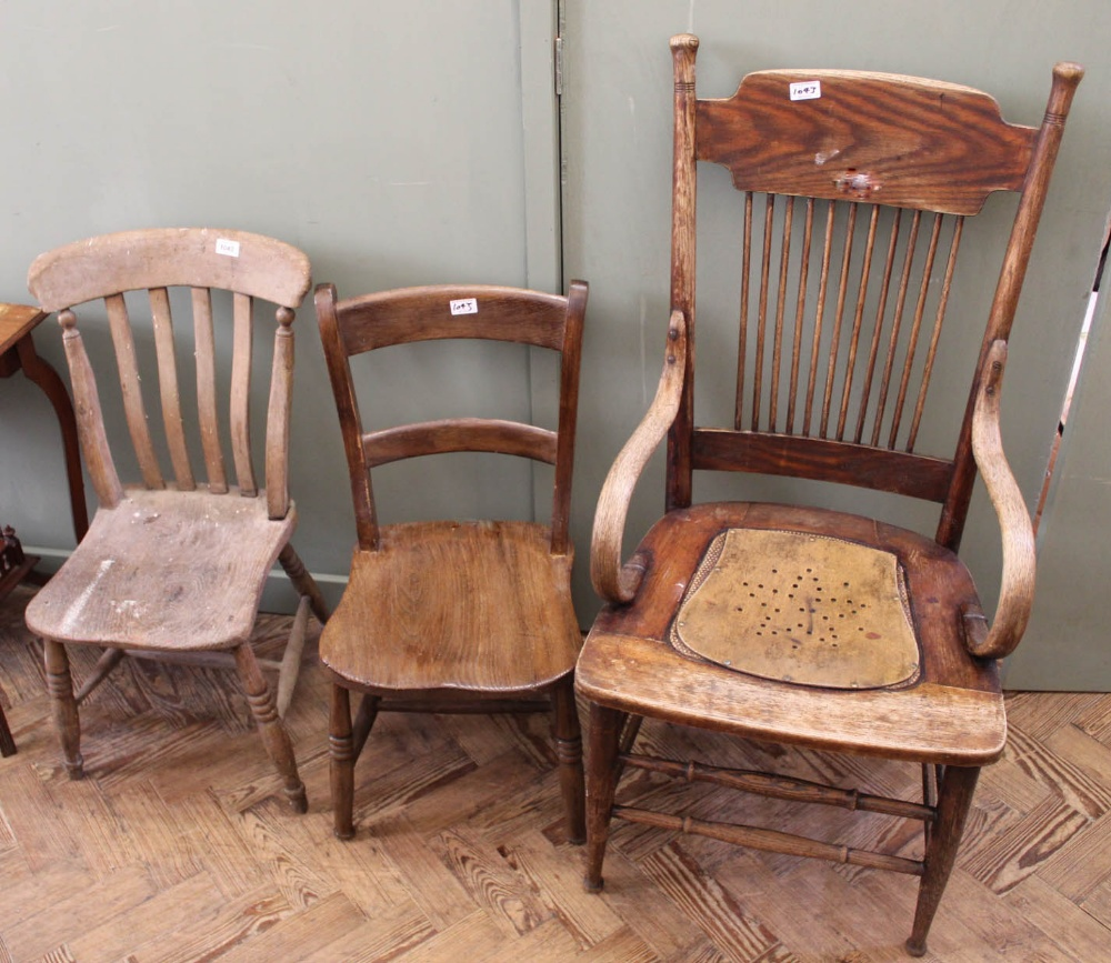 Lot 1043 - A bentwood armchair and two other cottage elm and beech chairs