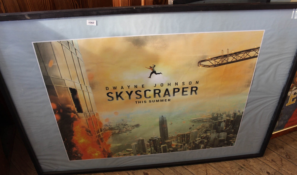 Lot 1060 - A framed and glazed print of film poster for 'Skyscraper'