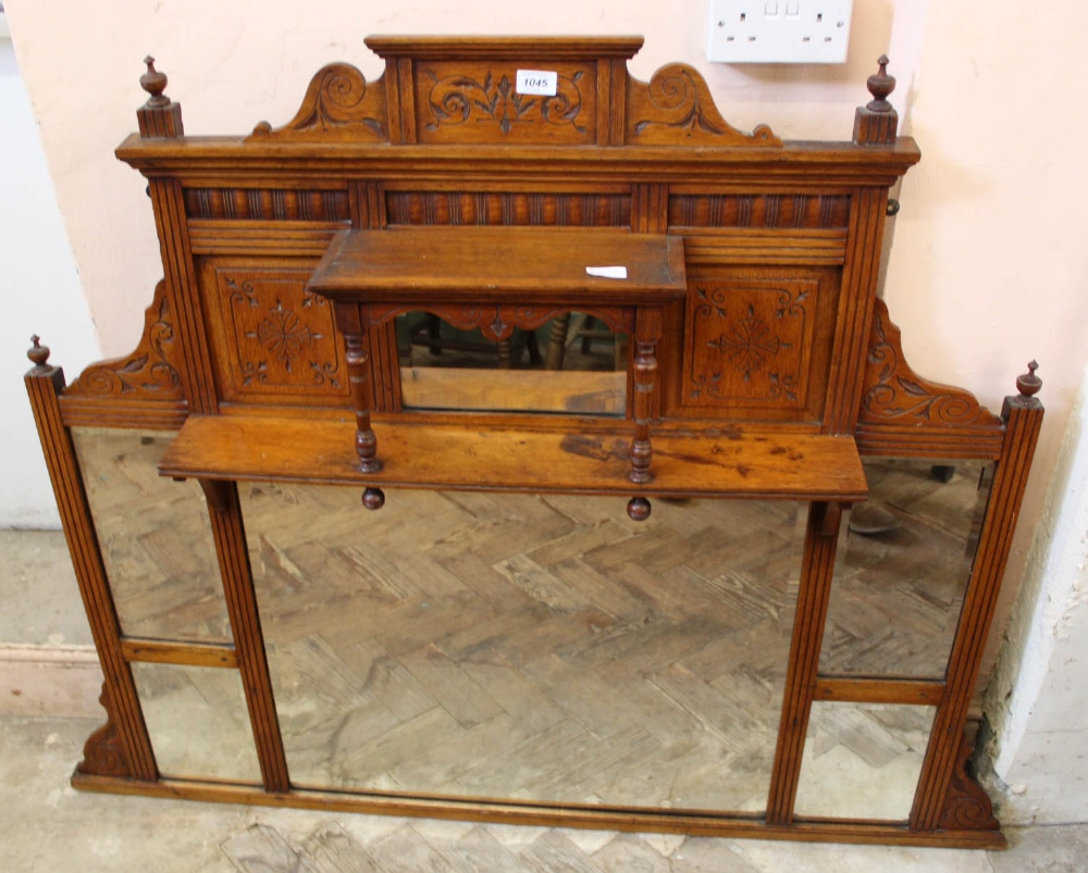 Lot 1045 - An Edwardian oak overmantel mirror