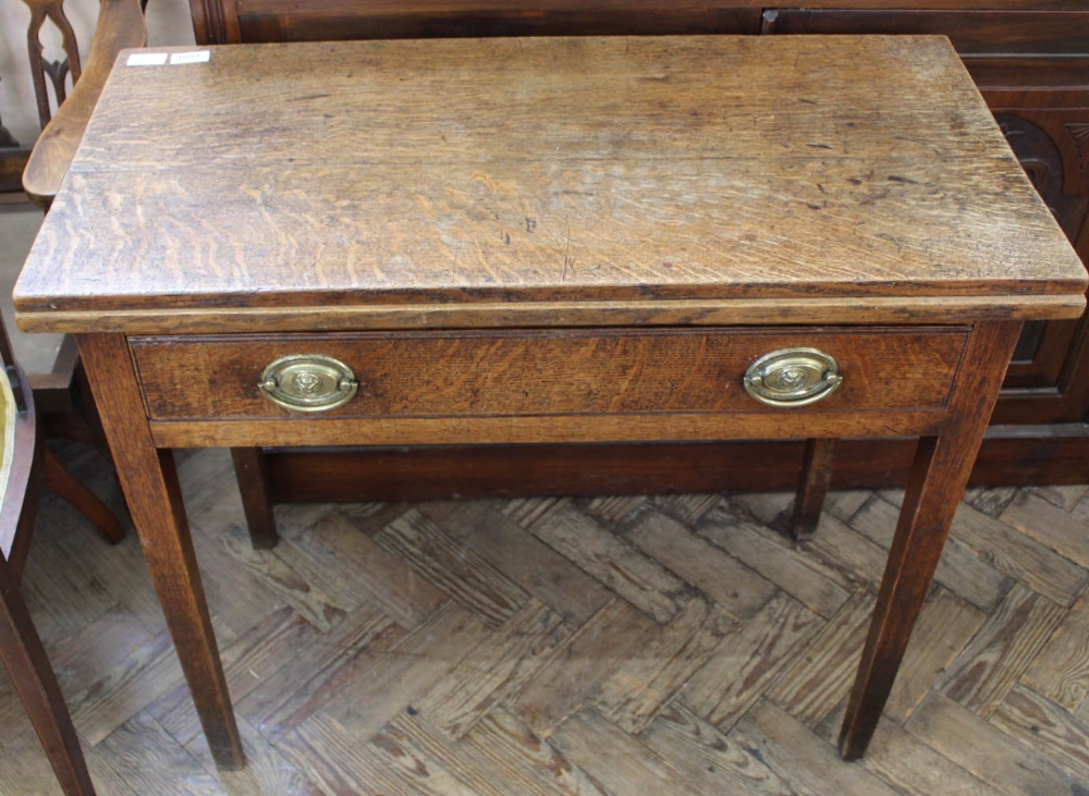 Lot 1051 - A 19th Century oak tea table with single drawer and original handles