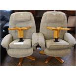 A pair of Relaxateeze recliners with beige upholstery and matching footstools