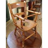An Edwardian elm child's chair