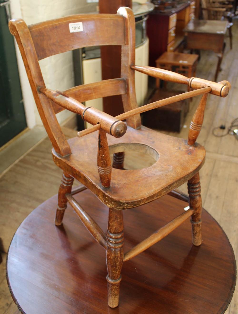 Lot 1014 - An Edwardian elm child's chair