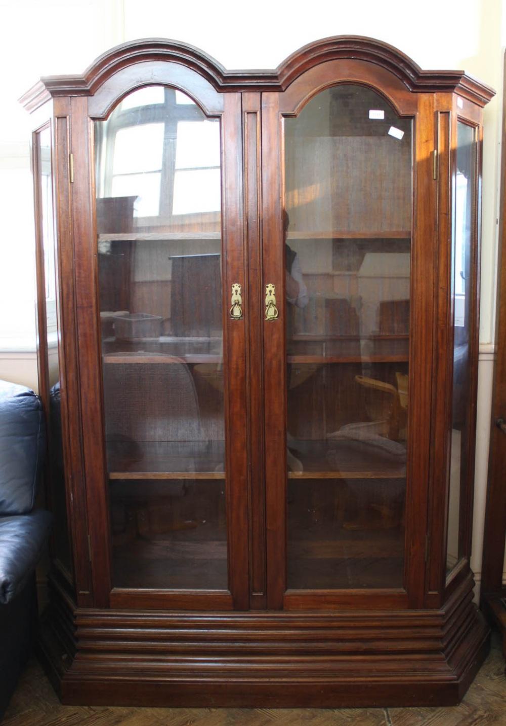 Lot 1031 - A substantial mahogany two door display cabinet