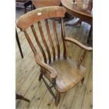 A Victorian elm seat armchair