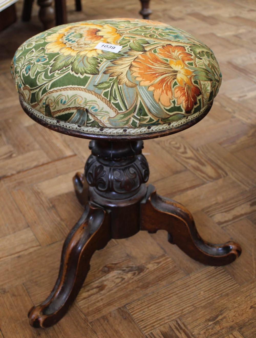 Lot 1039 - A Victorian carved mahogany revolving piano stool