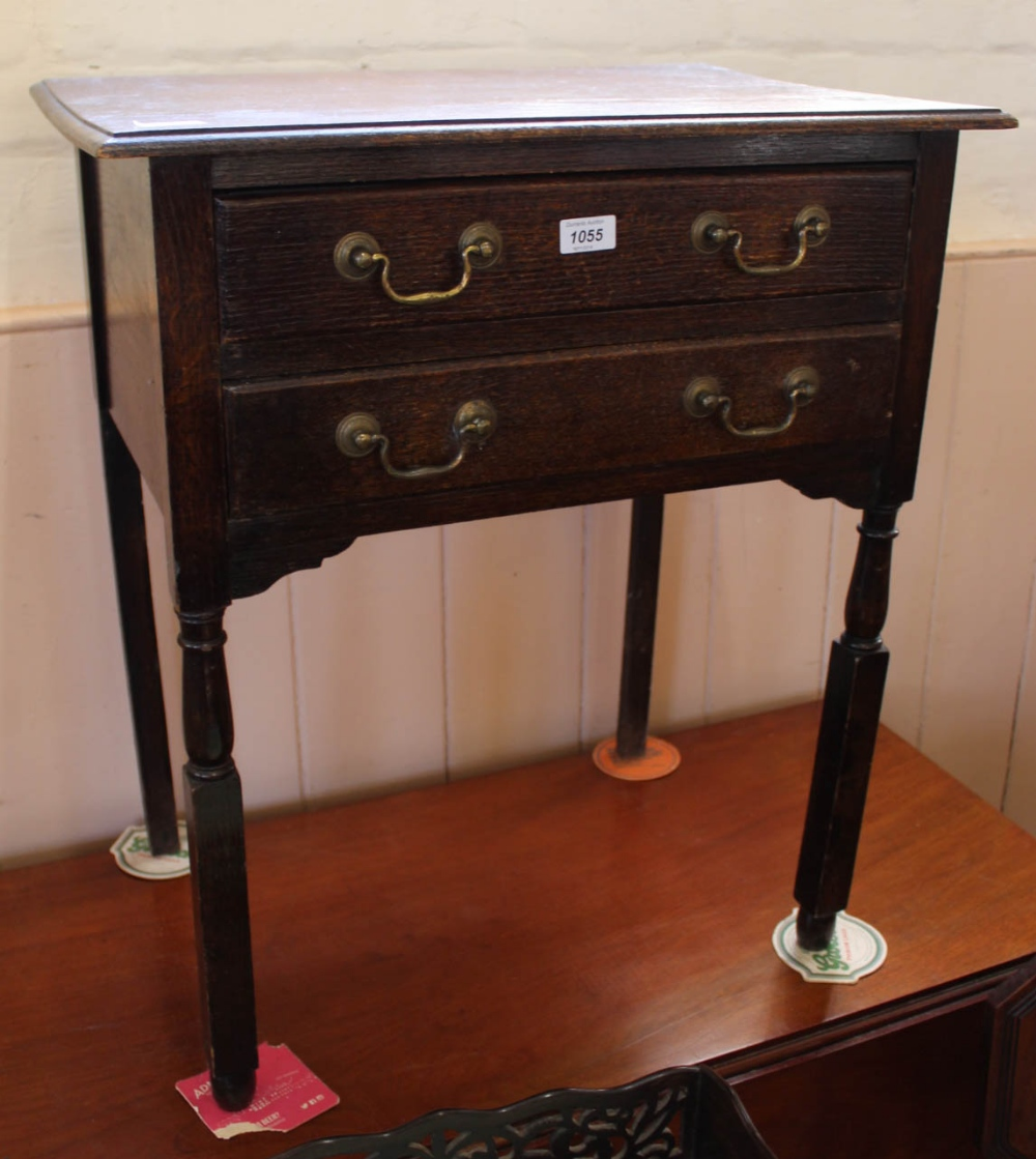 Lot 1055 - A 1920's oak two door work table with two drawers