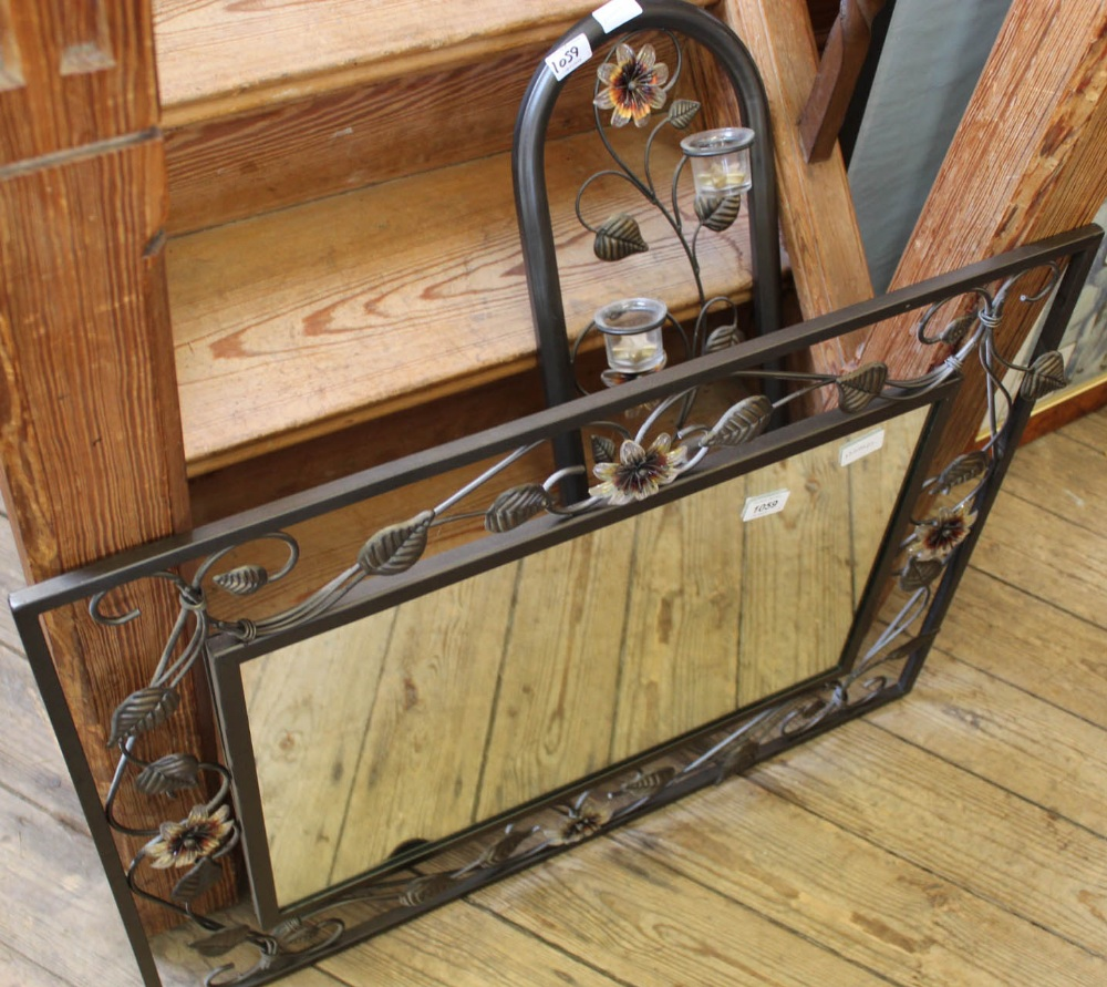 Lot 1059 - A modern metal mirror and decorative wall hanging candle holder