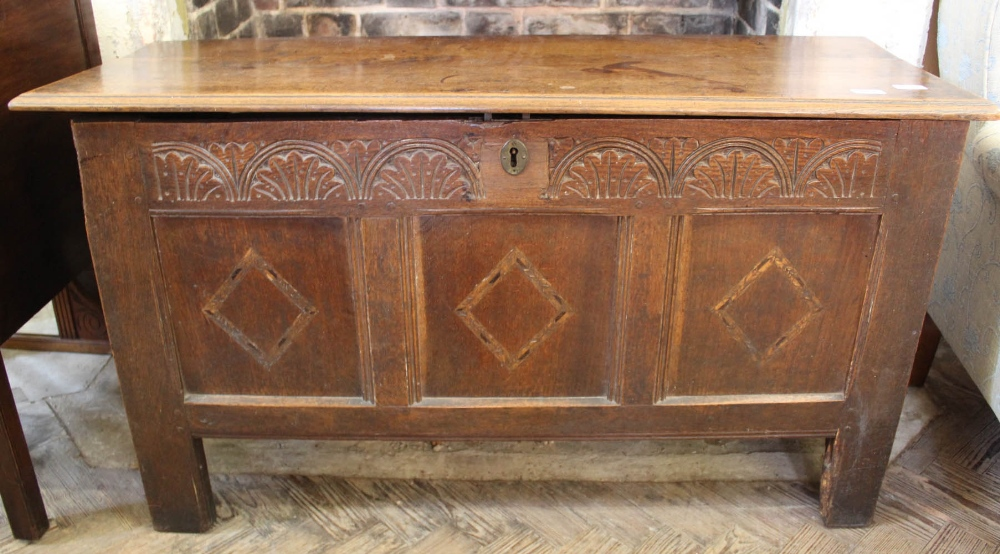 Lot 1047 - An early 19th Century carved coffer with inlaid panels