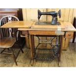 An oak Singer sewing machine with treadle,