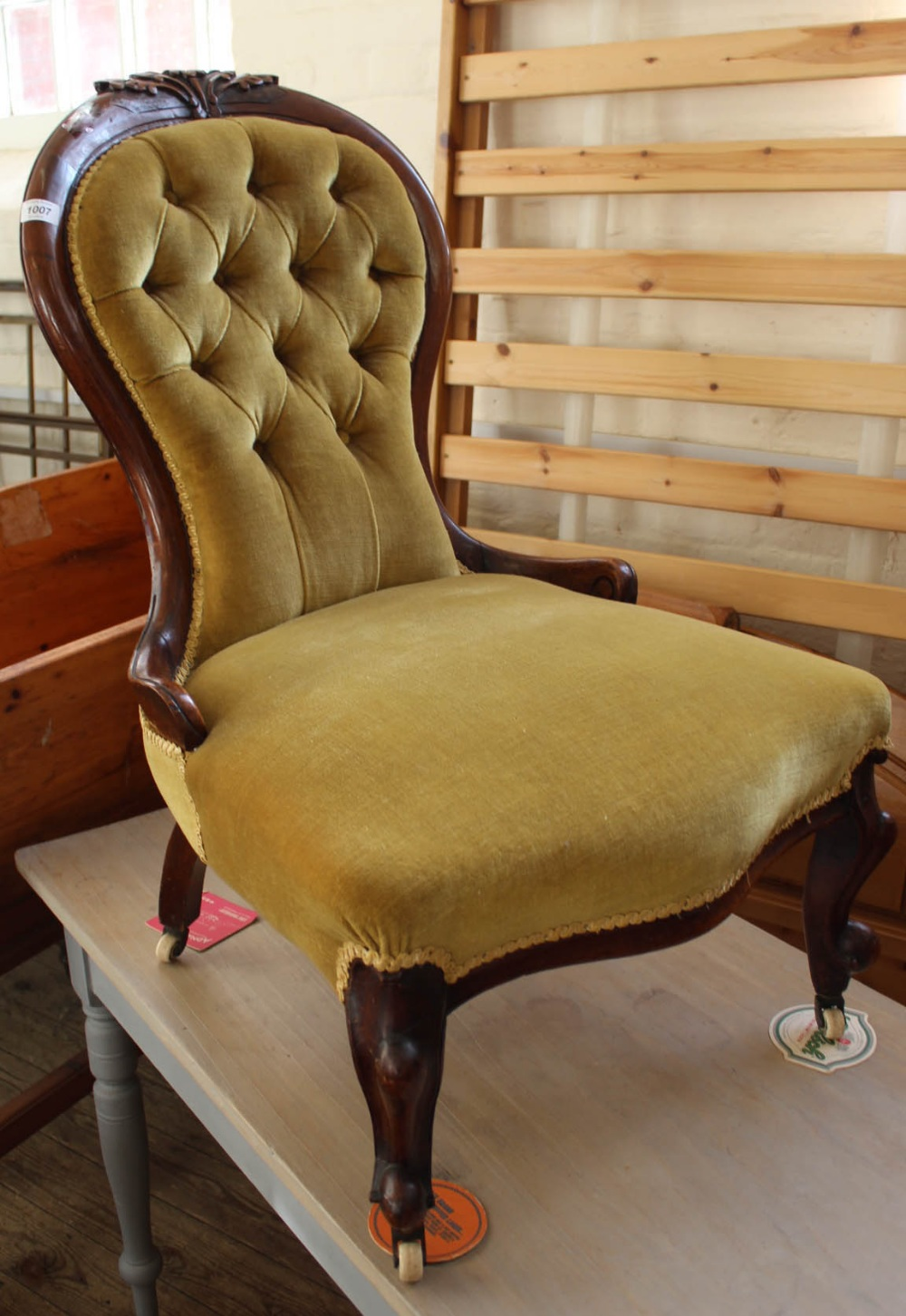 Lot 1007 - A Victorian mahogany balloon back nursing chair with gold button back upholstery