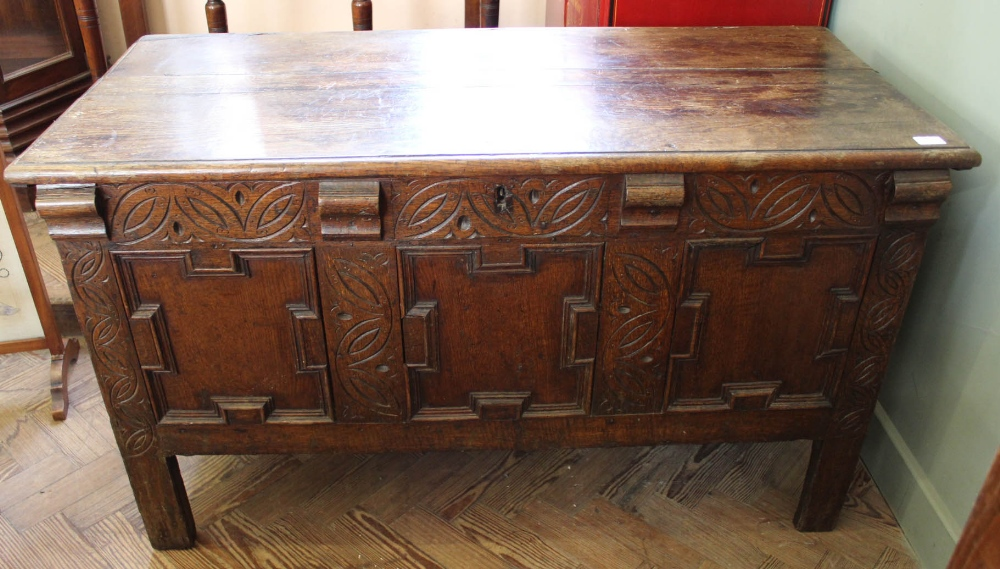 Lot 1035 - A late 18th Century carved oak coffer