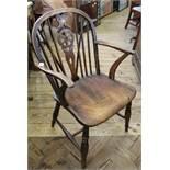 A 19th Century elm seat wheelback chair