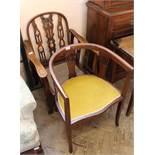 A 1920's reclining mahogany armchair and a inlaid mahogany tub chair