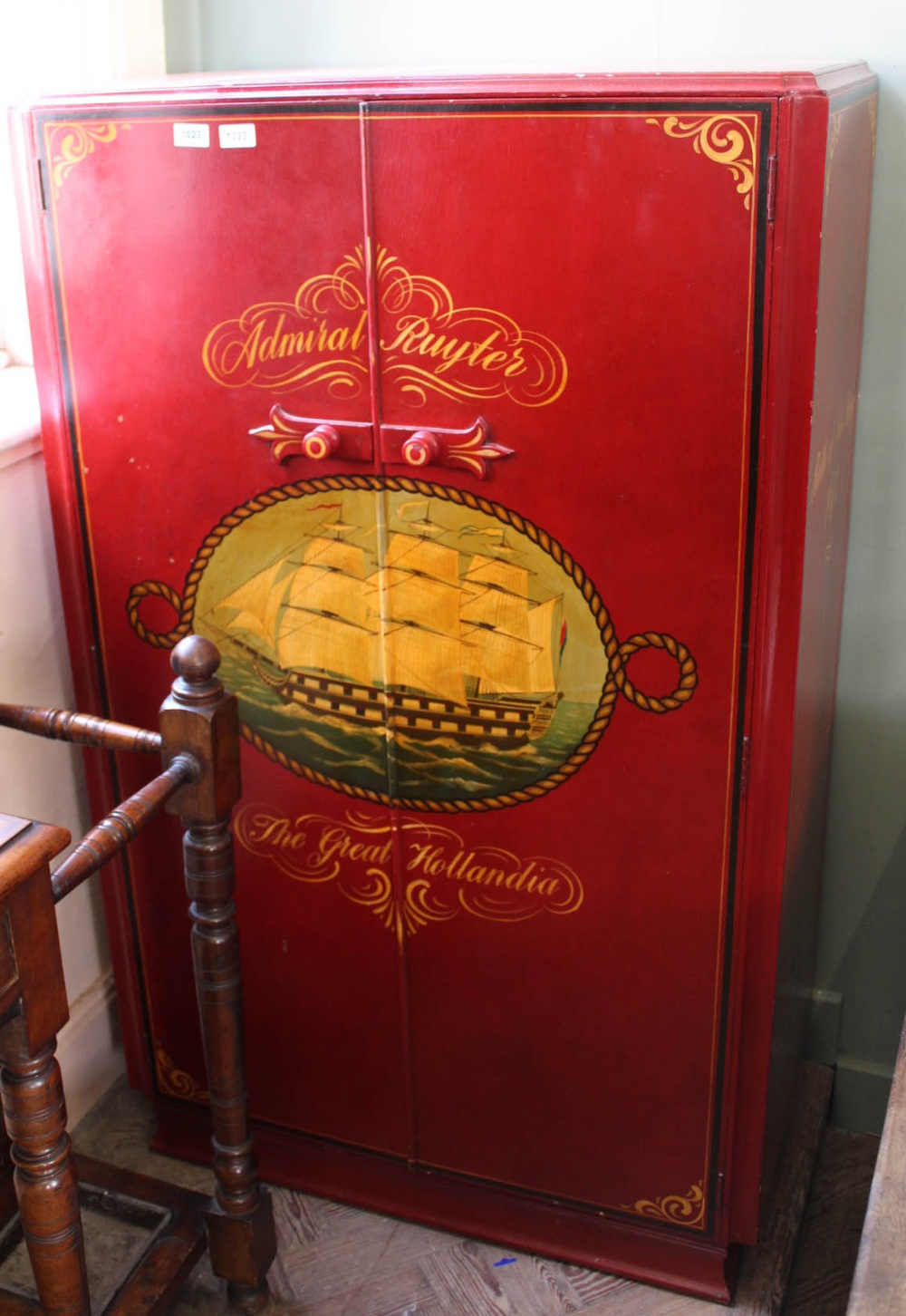 Lot 1033 - A hand painted child's wardrobe with Battle of Sole Bay decoration