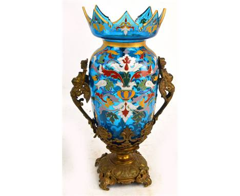 In the manner of LOBMEYR; a large blue glass enamel painted and gilt heightened vase held within a brass frame, the shaped to