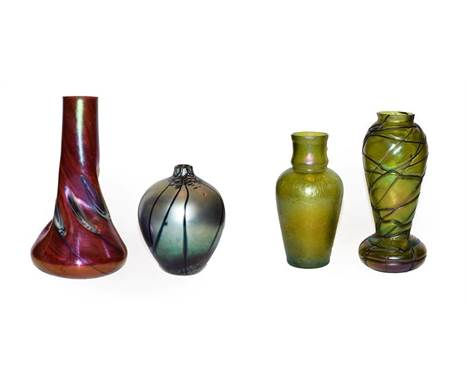 A Loetz style Art Nouveau iridescent glass vase with trailed decoration 24.5cm, together with three other iridescent glass va