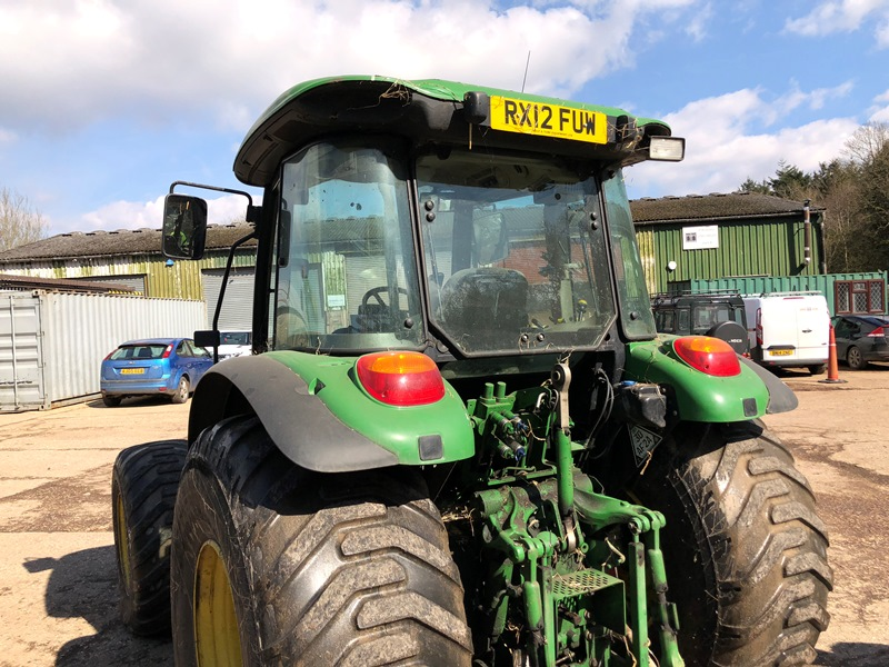 Lot 3 - John Deere 5100M four wheel drive tractor on grassland tyres with six 50kg John Deere front