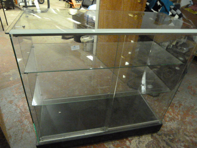Lot 40 - *Glass Display Cabinet with Sliding Door 92x102x46