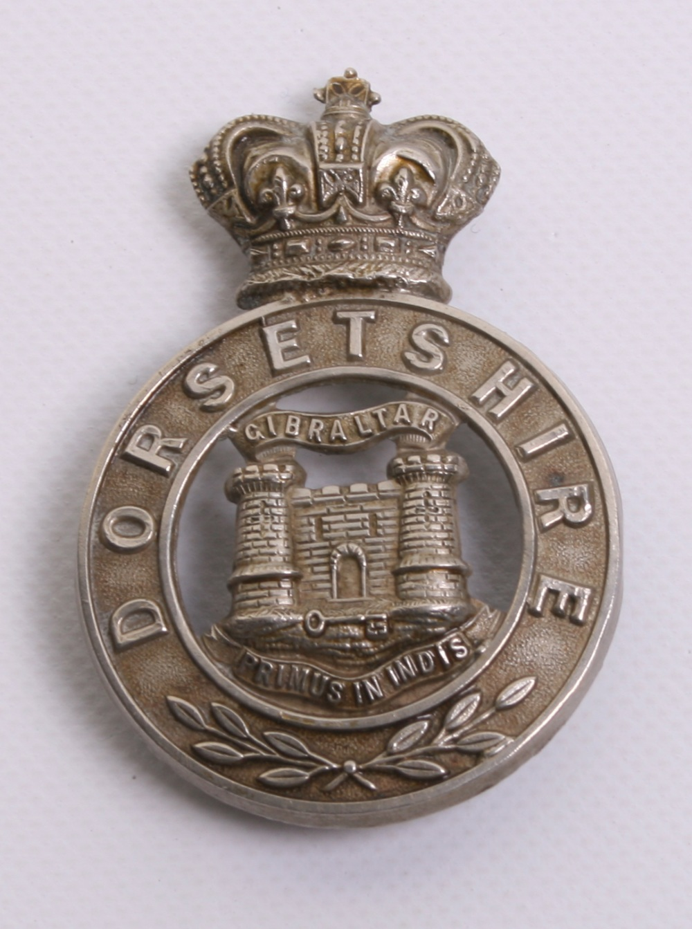 Lot 676 - Victorian Dorsetshire Militia Glengarry Badge of white metal with two loops to the reverse, top loop