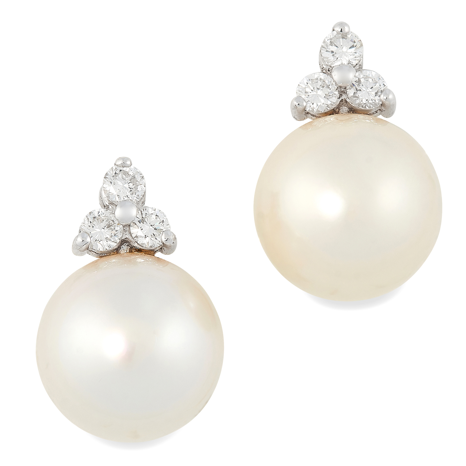 A PAIR OF PEARL AND DIAMOND EARRINGS each set with of a trio of round cut diamonds totalling 0.7-0.8