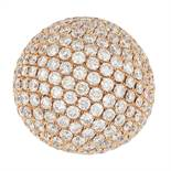 A DIAMOND COCKTAIL RING of bombe design, allover pave set with round cut diamonds totalling 14.0-