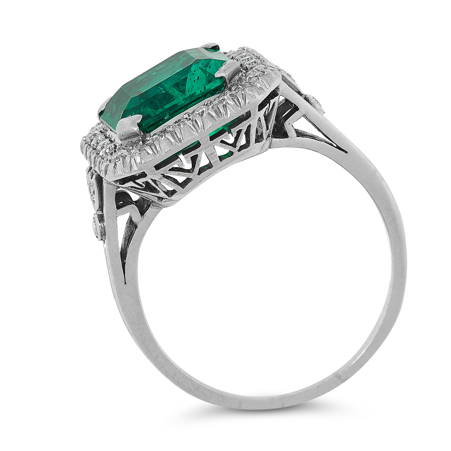 A COLOMBIAN EMERALD AND DIAMOND CLUSTER RING set with an emerald cut emerald of 2.84 carats in a - Image 2 of 2