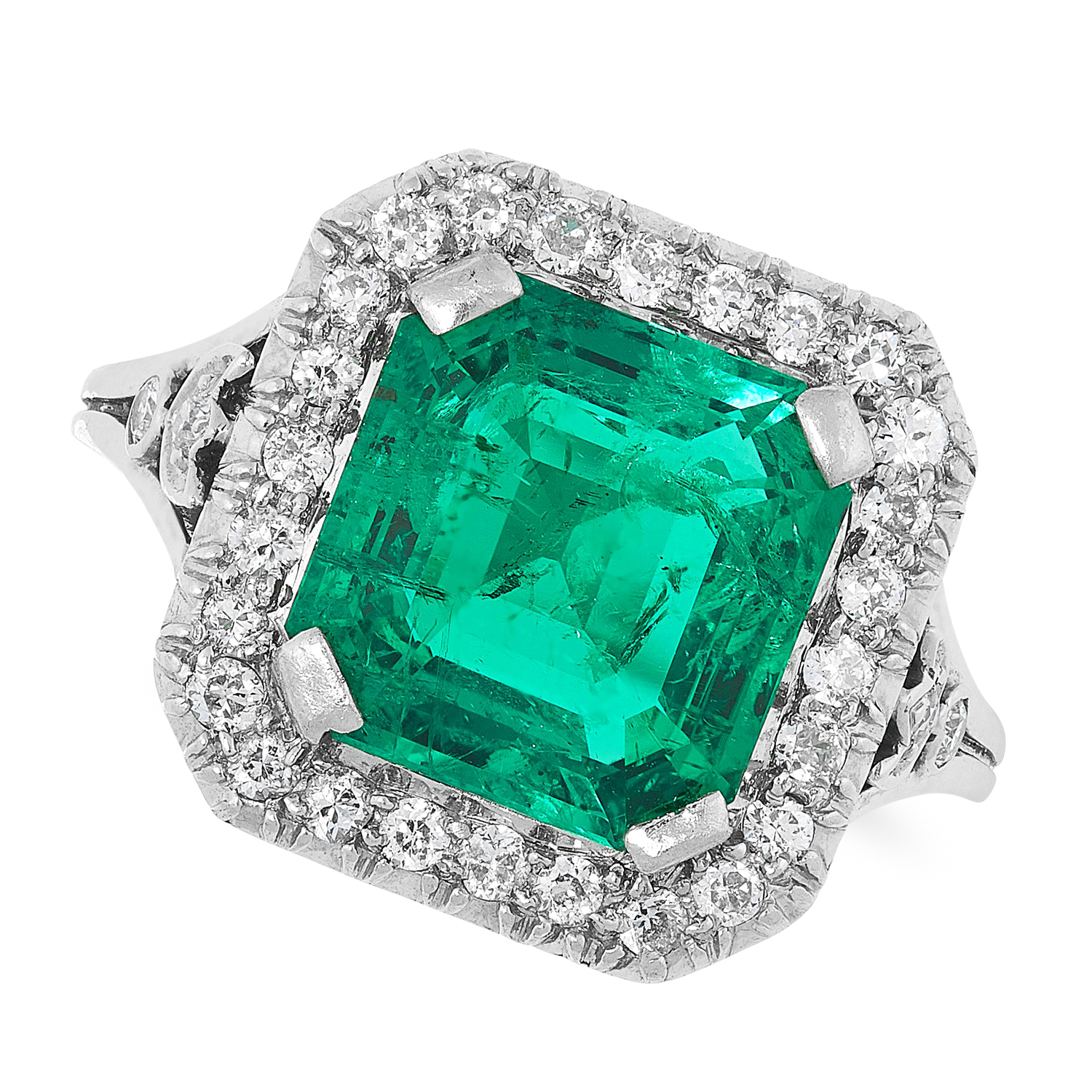 A COLOMBIAN EMERALD AND DIAMOND CLUSTER RING set with an emerald cut emerald of 2.84 carats in a