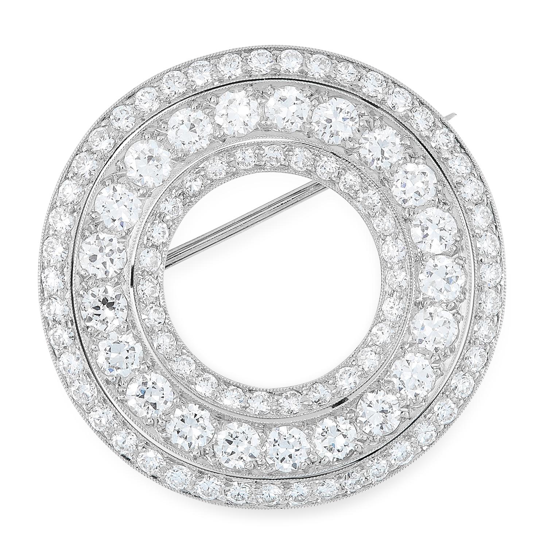 AN ART DECO DIAMOND BROOCH, CARTIER CIRCA 1930 in platinum, designed as an open circle set with