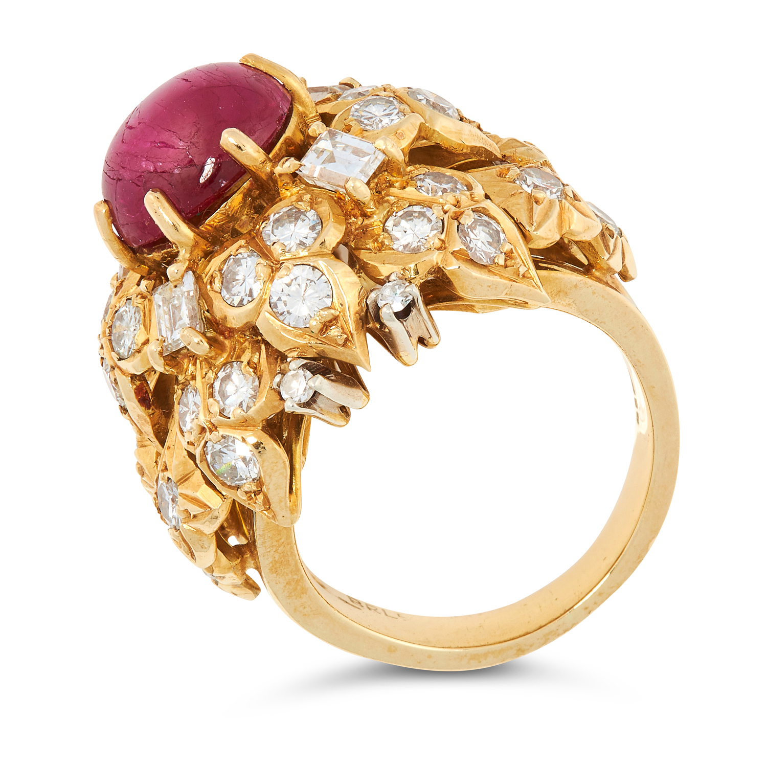 A VINTAGE RUBY AND DIAMOND RING, BEN ROSENFELD 1974 in 18ct yellow gold, set with an oval cabochon