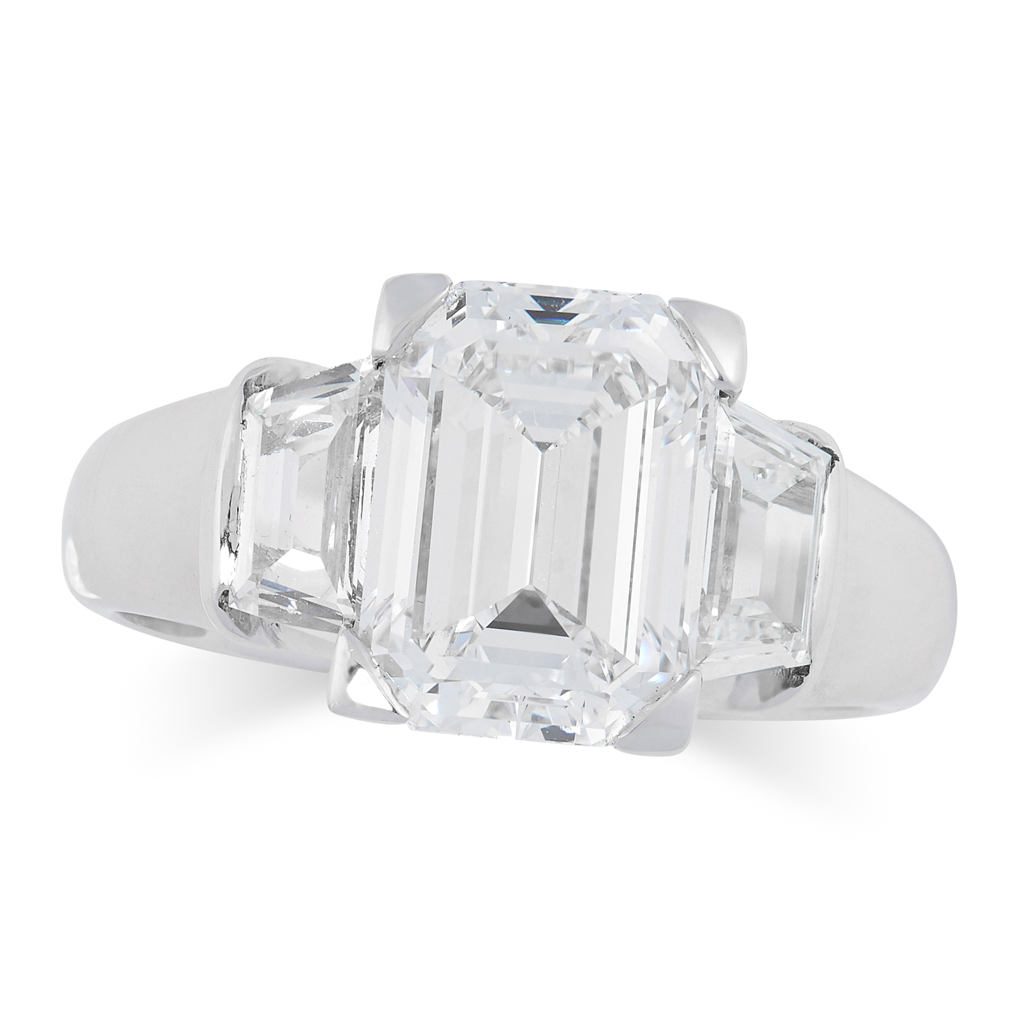 A 3.01 CARAT DIAMOND RING in 18ct white gold, set with an emerald cut diamond of 3.01 carats between