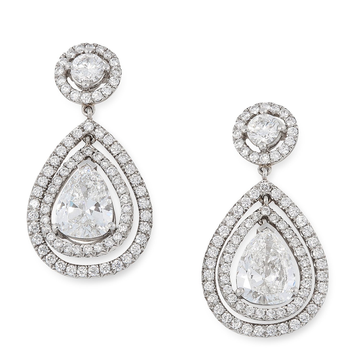 A PAIR OF DIAMOND DROP EARRINGS in white gold, each set with a pear cut diamond of 1.01 carats,