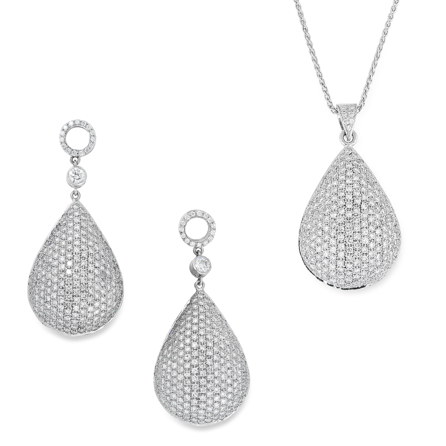 A DIAMOND PENDANT AND EARRINGS SUITE comprising a pair of earrings, pendant and chain, in teardrop