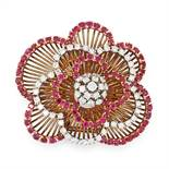 A VINTAGE RUBY AND DIAMOND BROOCH, CIRCA 1960 in high carat yellow gold, designed as a cluster of