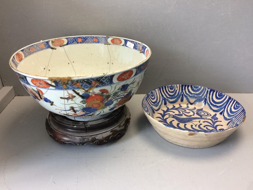 Lot 41 - Large (40 cm dia) Imari pattern bowl on stand ( bowl riveted) & terracotta bowl (cracked)