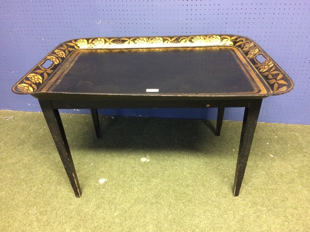 Lot 617 - Japanned & gilt metal tray on a stand 77 x 56 x 48 cm