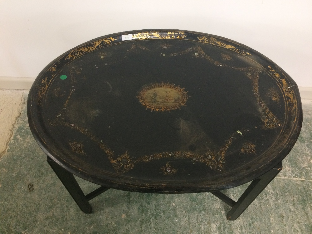 Lot 276 - Oval toleware tray on a stand ( worn)