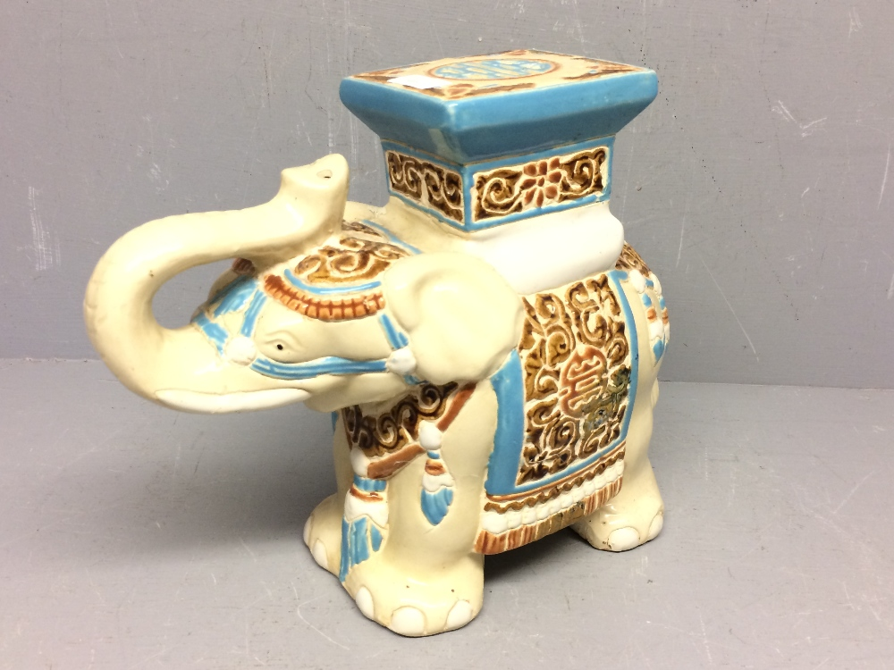 Lot 46 - Chinese elephant stand in pastel colours on cream 29 cm