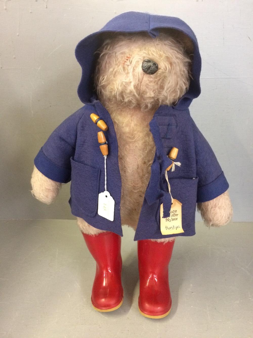 Lot 145 - Paddington bear n blue duffle coat 54 cm