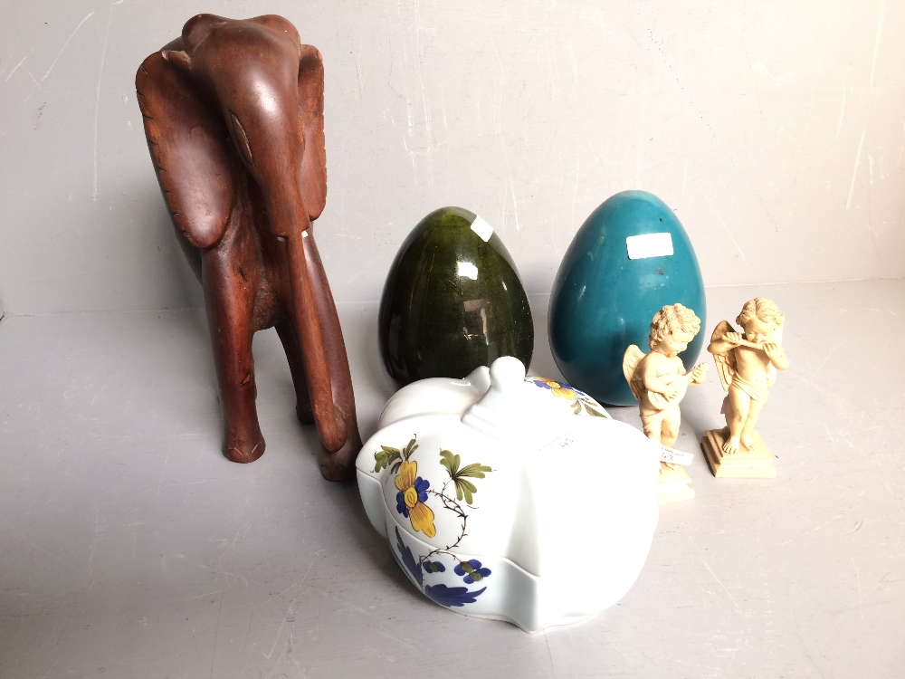 Lot 43 - 2 China finials, Italian lidded porcelain container, wooden elephant, 2 puti