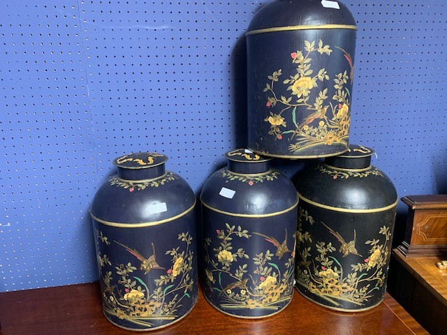 Lot 139 - 3 Dark blue & 1 black tea canisters decorated with flowers & birds