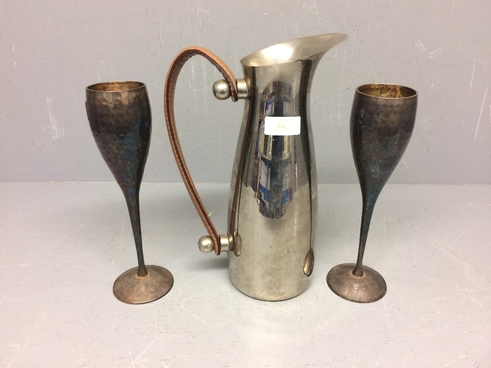 Lot 59 - 2 White metal champagne flutes, stainless steel water jug with leather handles