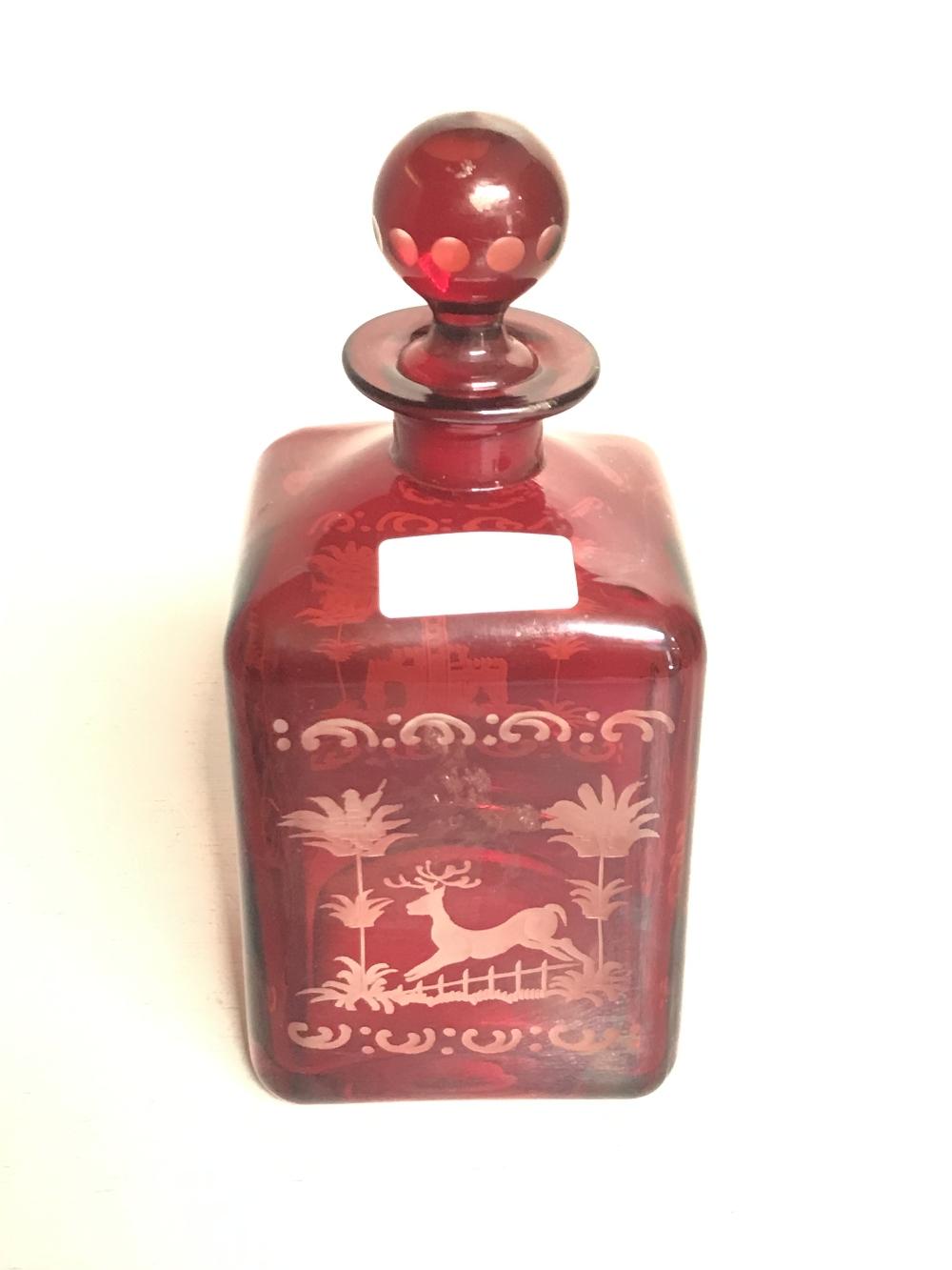 Lot 65 - A spirit or liqueur decanter, ruby cut clear glass possibly Czech 21 cm