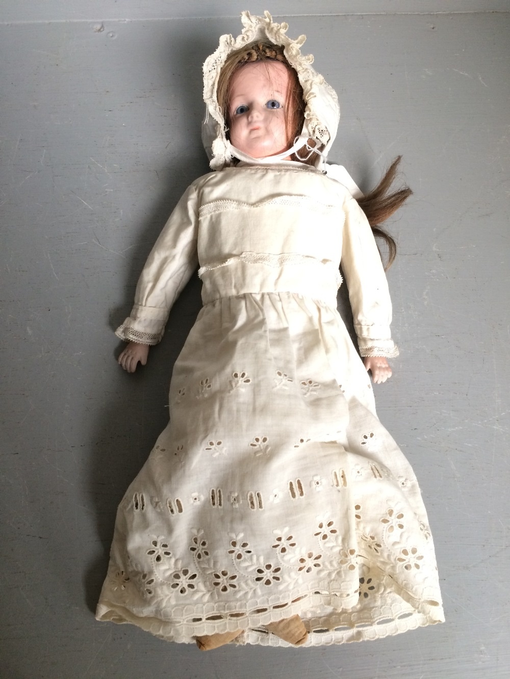 Lot 131 - Unmarked porcelain bodied & headed doll with original clothes 39 cm