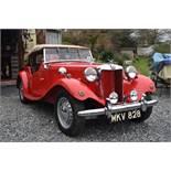 A 1953 MG TD Registration number MKV 828 Chassis number TD/28408 Engine number TD2/28446 Red with