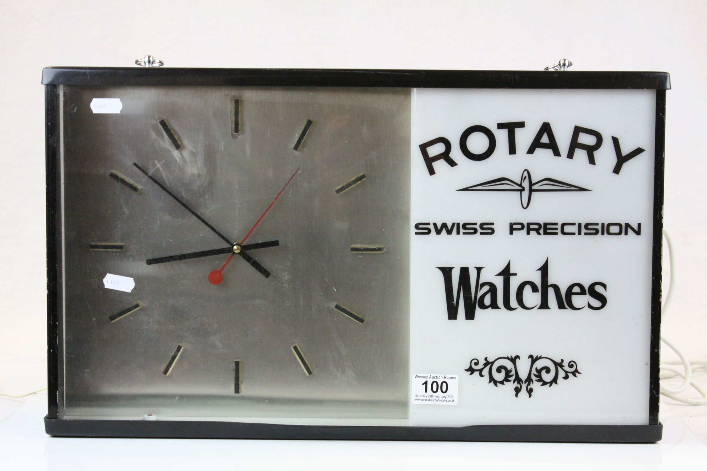"Advertising electric Wall Clock for ""Rotary Swiss Precision Watches"", measures approx 51 x 31 x"