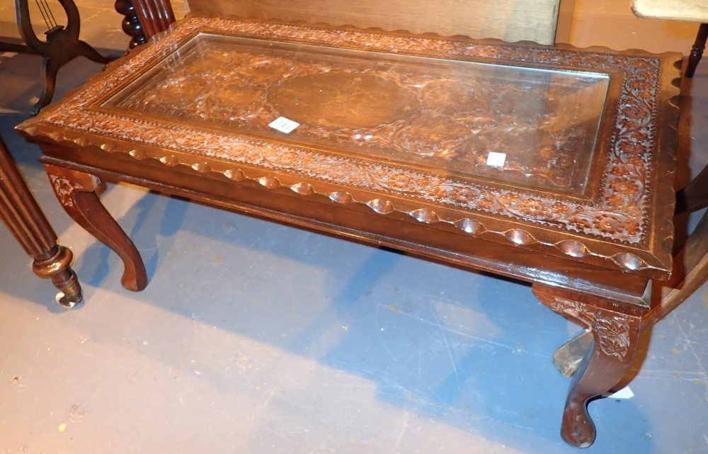 Carved hardwood Oriental style coffee table with brass inlay