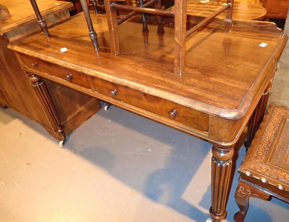 Lot 741 - Mahogany side table with two drawers on fluted tapering supports 120 x 56 x 75 cm H
